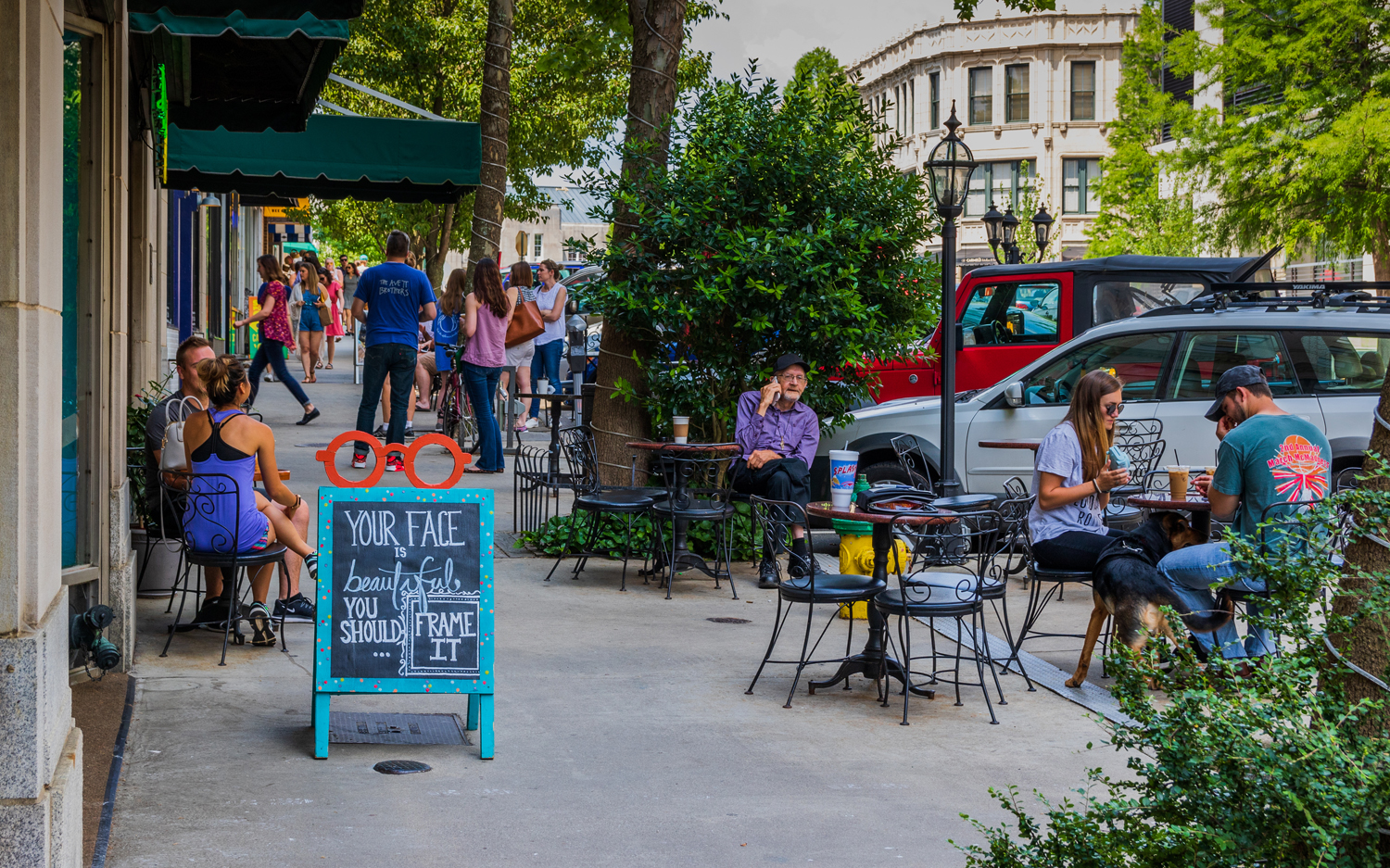 Dining and socializing on a sunny Sunday on Battery Park Ave in Asheville.