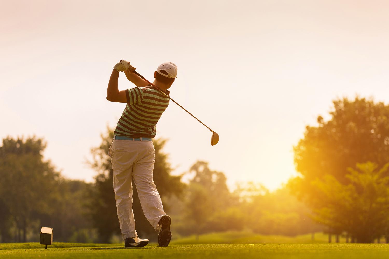 Golfer swinging golf club on Kiawah Island
