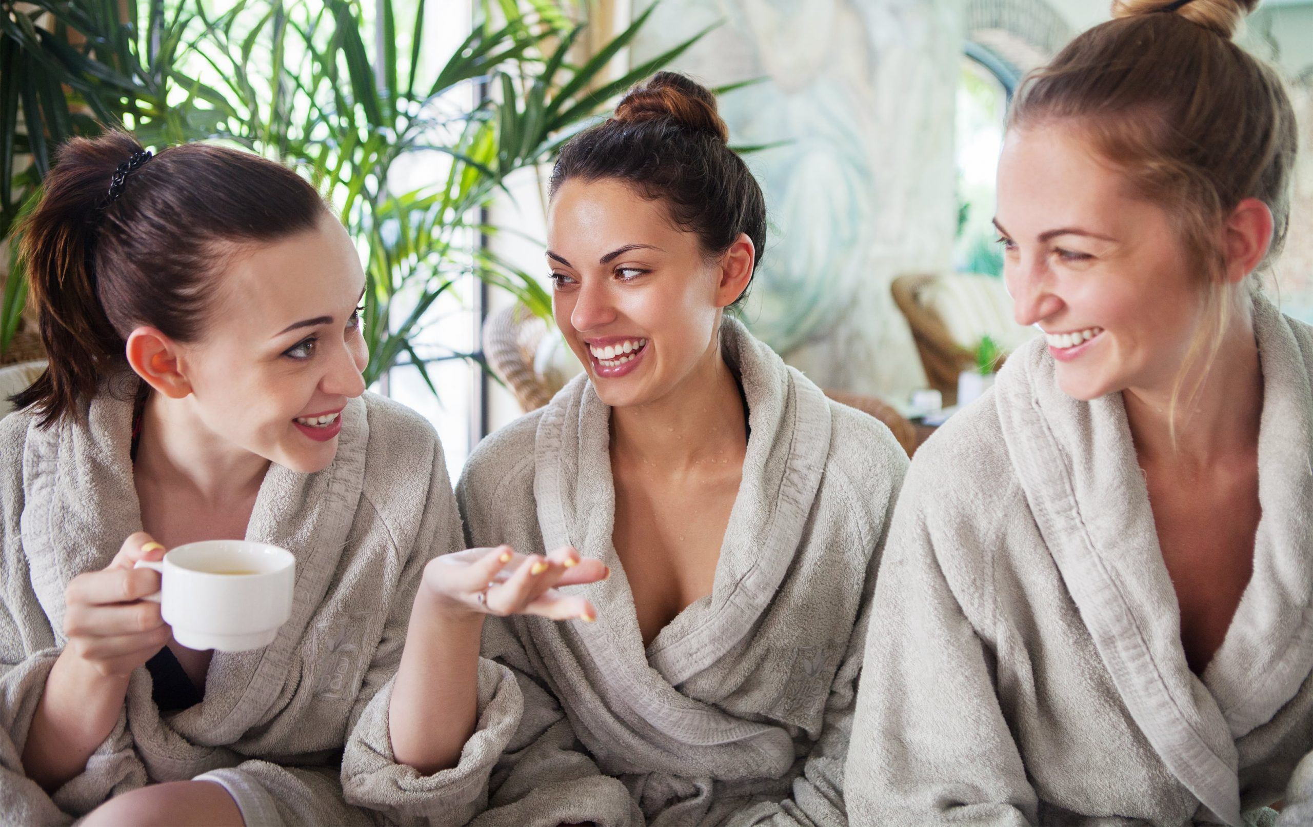 Friends enjoying in Towel Robe at a boutique hotel